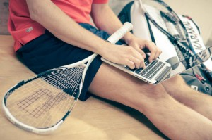 working in shorts with raquet