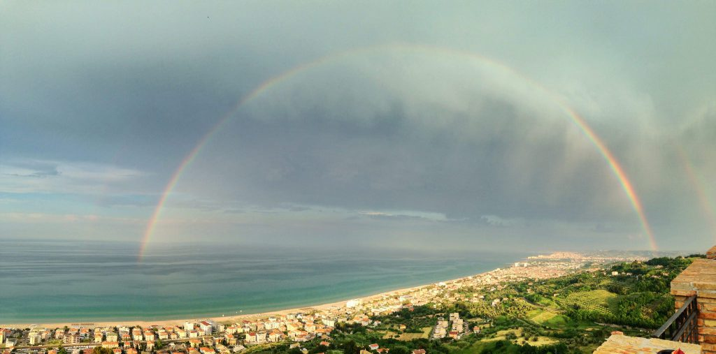rainbow over the coastline