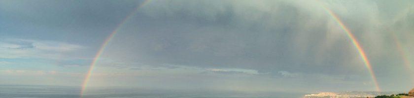 rainbow over a coastline