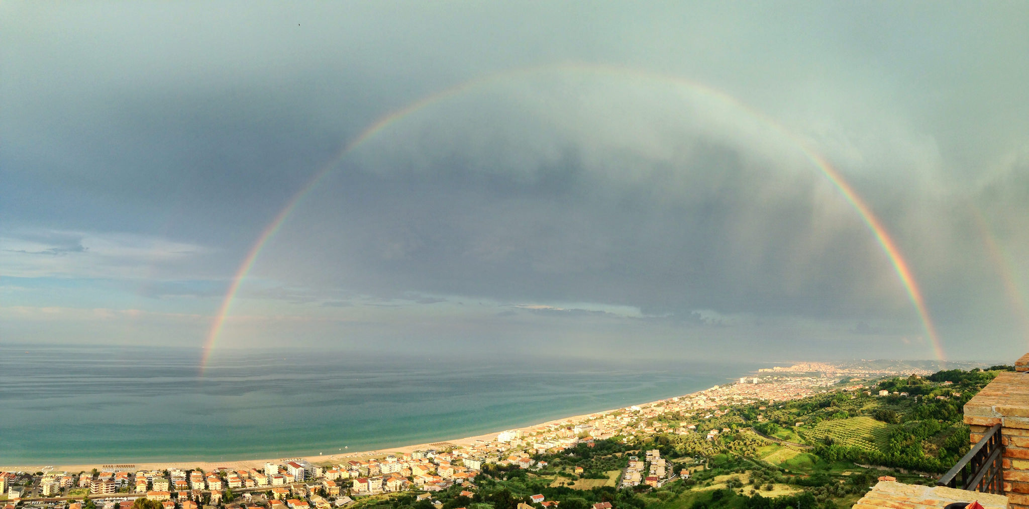 rainbow over a coastline